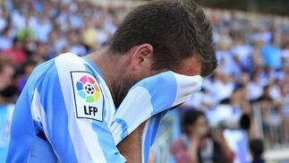 El Málaga solo pudo conseguir un empate (1-1) ante el Sporting que le acerca más a los puestos de descenso la victoria del Tenerife.